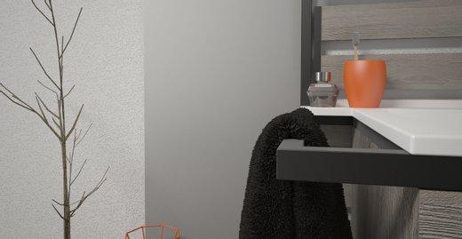 Der seitlich überstehende Rahmen kann als Handtuchhalter oder Haltegriff genutzt werden.