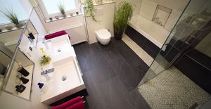 Renovierung mit AEG Fußbodentemperierung:  Wohlfühlen beginnt im Bad