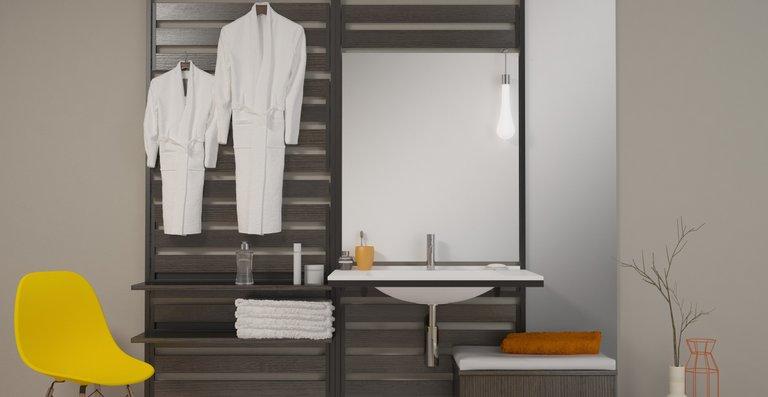 Waschtisch-Lösung mit mobilem Sitzrolley.