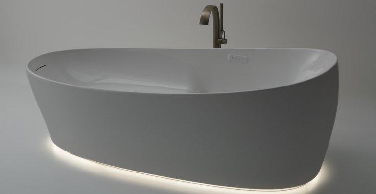 Die feine Linienführung wird von einem unter der Wanne verlaufenden, beleuchteten LED-Lichtband unterstrichen, das eine stimmungsvolle Atmosphäre erzeugt.