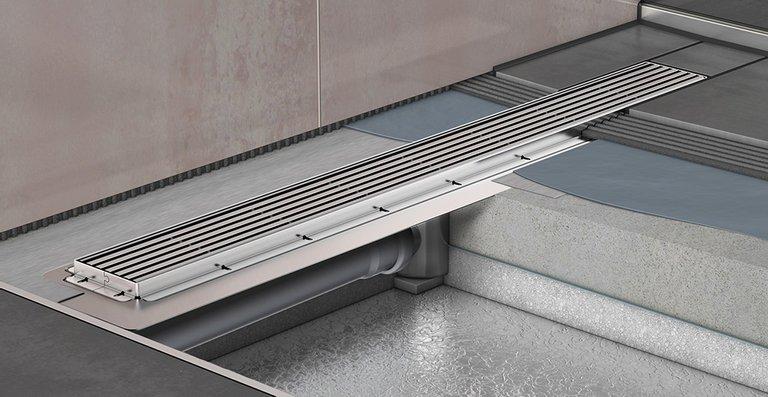 Bodenaufbau eines barrierefreien Duschplatzes mit der neuen Edelstahl-Duschrinne ACO ShowerDrain E+.