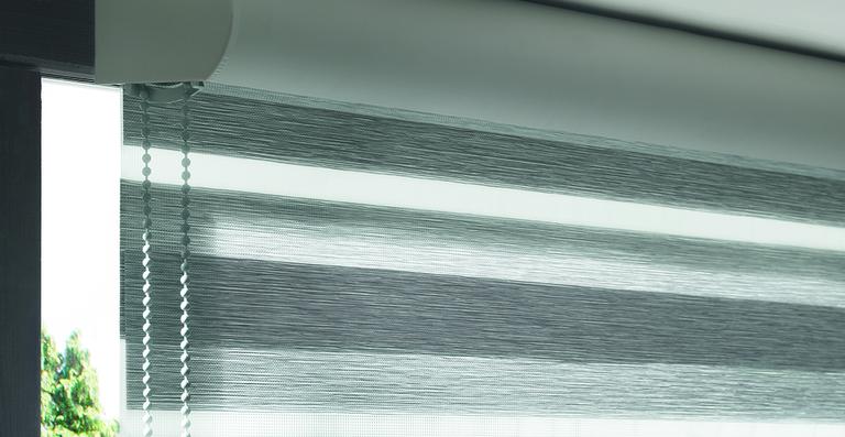 Die formschöne Rundblende ist wahlweise in grau oder weiß erhältlich.