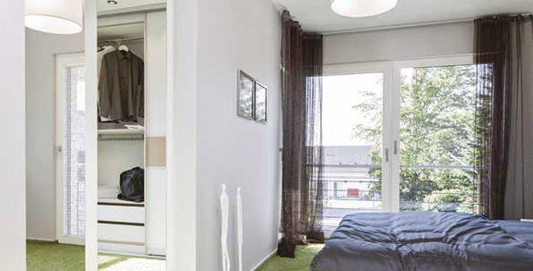 Schlafzimmer mit Ankleide Copyright: WeberHaus