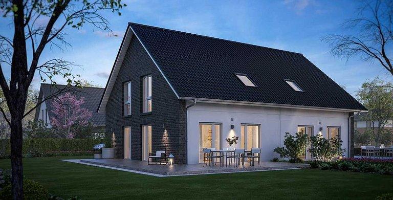 Schon von Weitem ein schöner Anblick: das Doppelhaus V4 mit seiner markanten Fassade. Copyright: