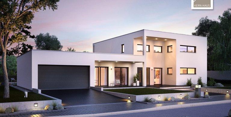 Das Bauhaus Ixeo von Kern-Haus überzeugt von der Eingangsseite mit einer Überdachung von der Garage bis ins Haus. Copyright:
