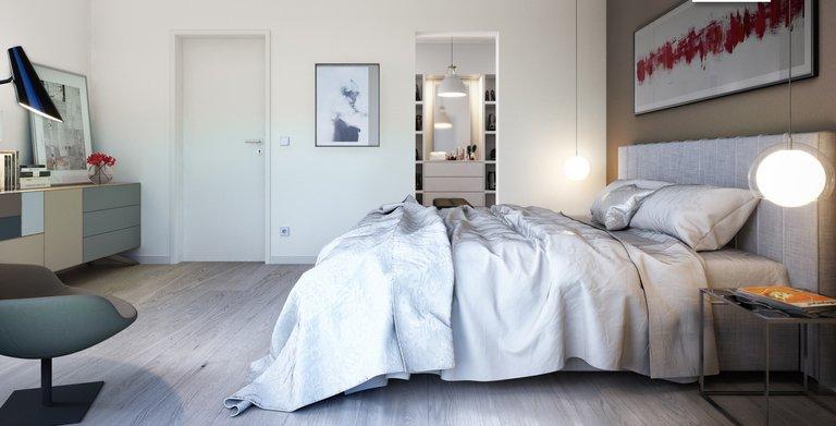 Das Schlafzimmer beim Futura Bauhaus verfügt über eine angrenzende Ankleide. Copyright: