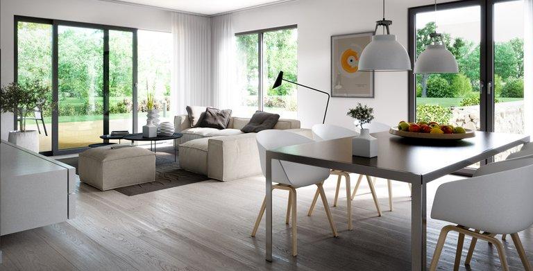 Das Wohnzimmer des Futura Bauhaus verfügt über bodentiefe Fensterelemente. Copyright: