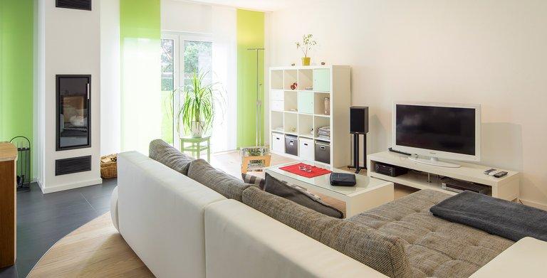 Wohnzimmer mit Ofen Copyright: FingerHaus