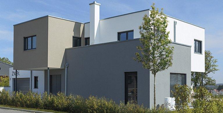 Die Farbgestaltung der Fassade unterstreicht den modernen Charakter des Hauses Copyright: Wolf-Haus