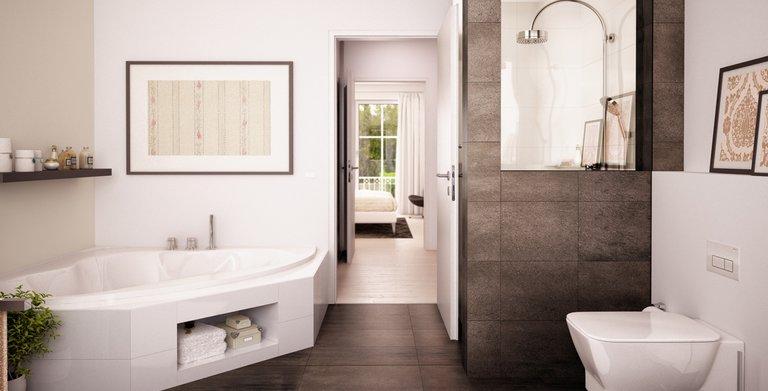 Das Badezimmer überzeugt mit einer bodentief gefliesten Dusche und einer großen Badewanne. Copyright:
